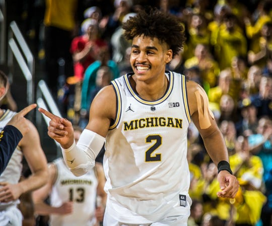 Michigan guard Jordan Poole reacts as he runs off the court at the end of the first half on Saturday, Dec. 15, 2018, at Crisler Center.