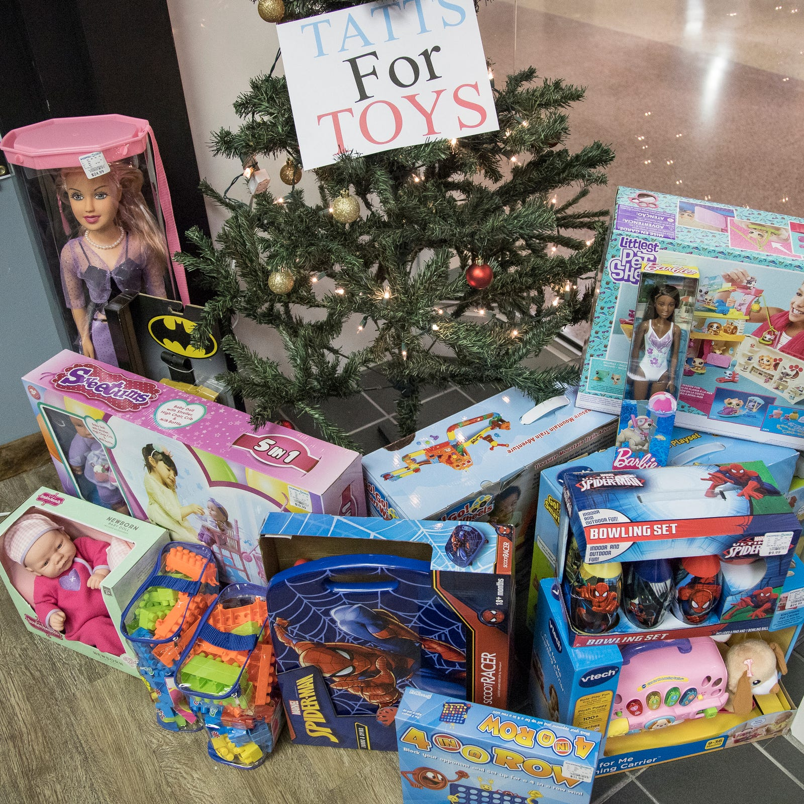 Metro Detroit tattoo shop starts Christmas toy drive with a twist