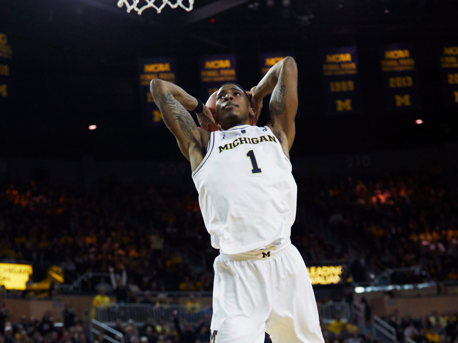 Michigan guard Charles Matthews dunks in the first half on Saturday, Dec. 15, 2018, at Crisler Center.