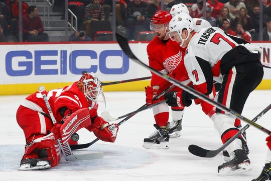 Detroit Red Wings goaltender Jimmy Howard (35) stops a Ottawa Senators' Brady Tkachuk (7) shot in the first period of an NHL hockey game Friday, Dec. 14, 2018, in Detroit.