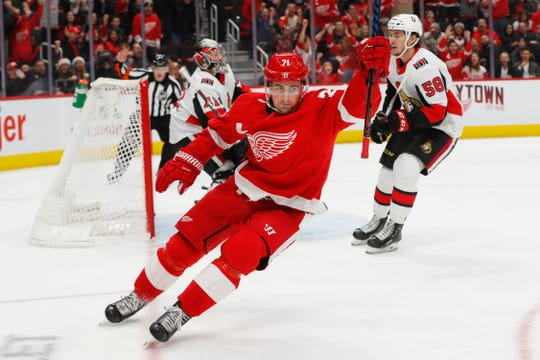 Detroit Red Wings center Dylan Larkin (71) celebrates his goal against Ottawa Senators goaltender Craig Anderson (41) in the second period of an NHL hockey game Friday, Dec. 14, 2018, in Detroit.