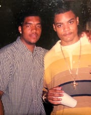 Joseph Semien, left, hangs out with best friend Max Madhere in downtown New Orleans in 2000.