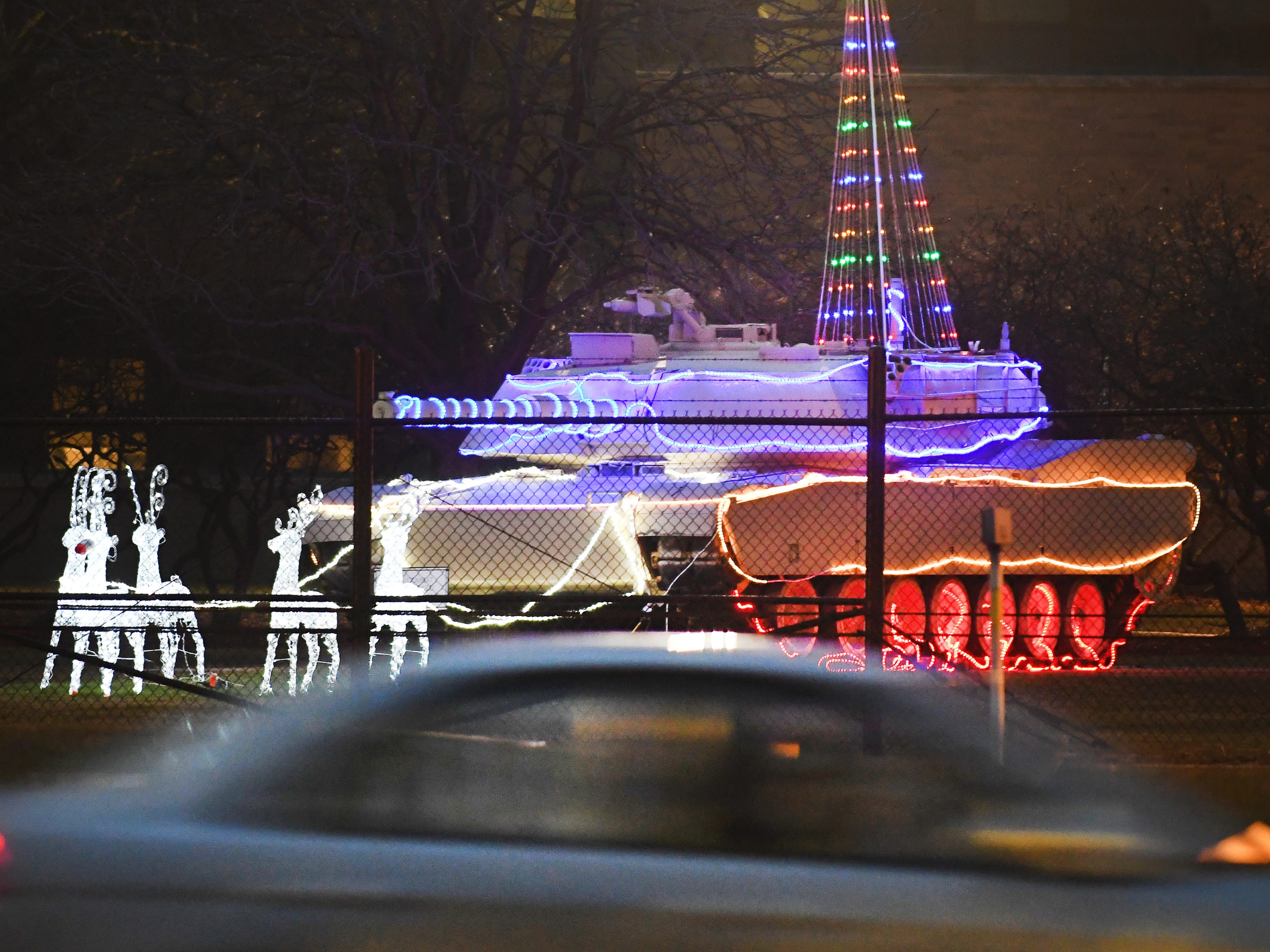 A decorated tank in front of the U.S. Army Tank Automotive Command sends a cheery yet formidable holiday greeting off E. 11 Mile in Warren, Michigan, on Dec. 14, 2018.