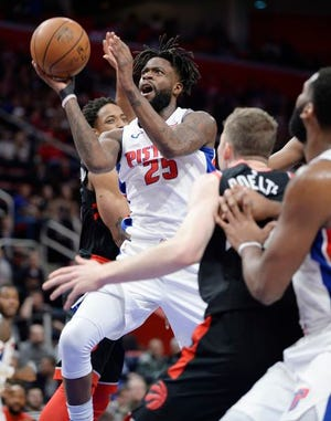 The Pistons have missed the 3-point shooting of Reggie Bullock, left. Bullock has missed the last five games with a sprained ankle.
