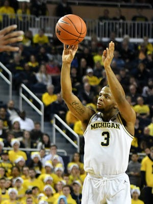 Michigan guard Zavier Simpson takes and hits a 3-pointer against Western Michigan in Saturday's win.