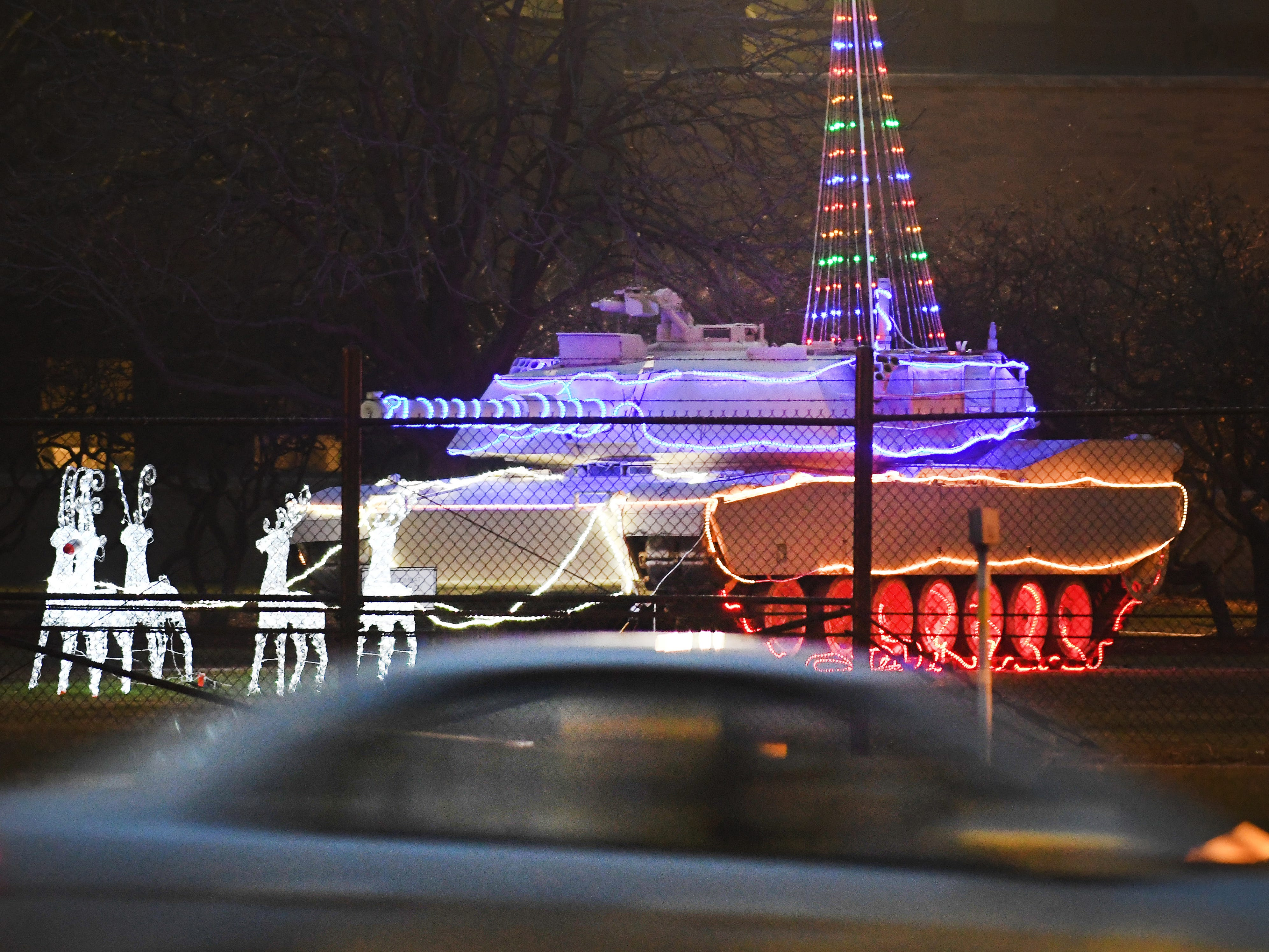 A decorated tank in front of the U.S. Army Tank Automotive Command sends a cheery, yet deadly holiday greeting off of E. Eleven Mile Road in Warren, Michigan.