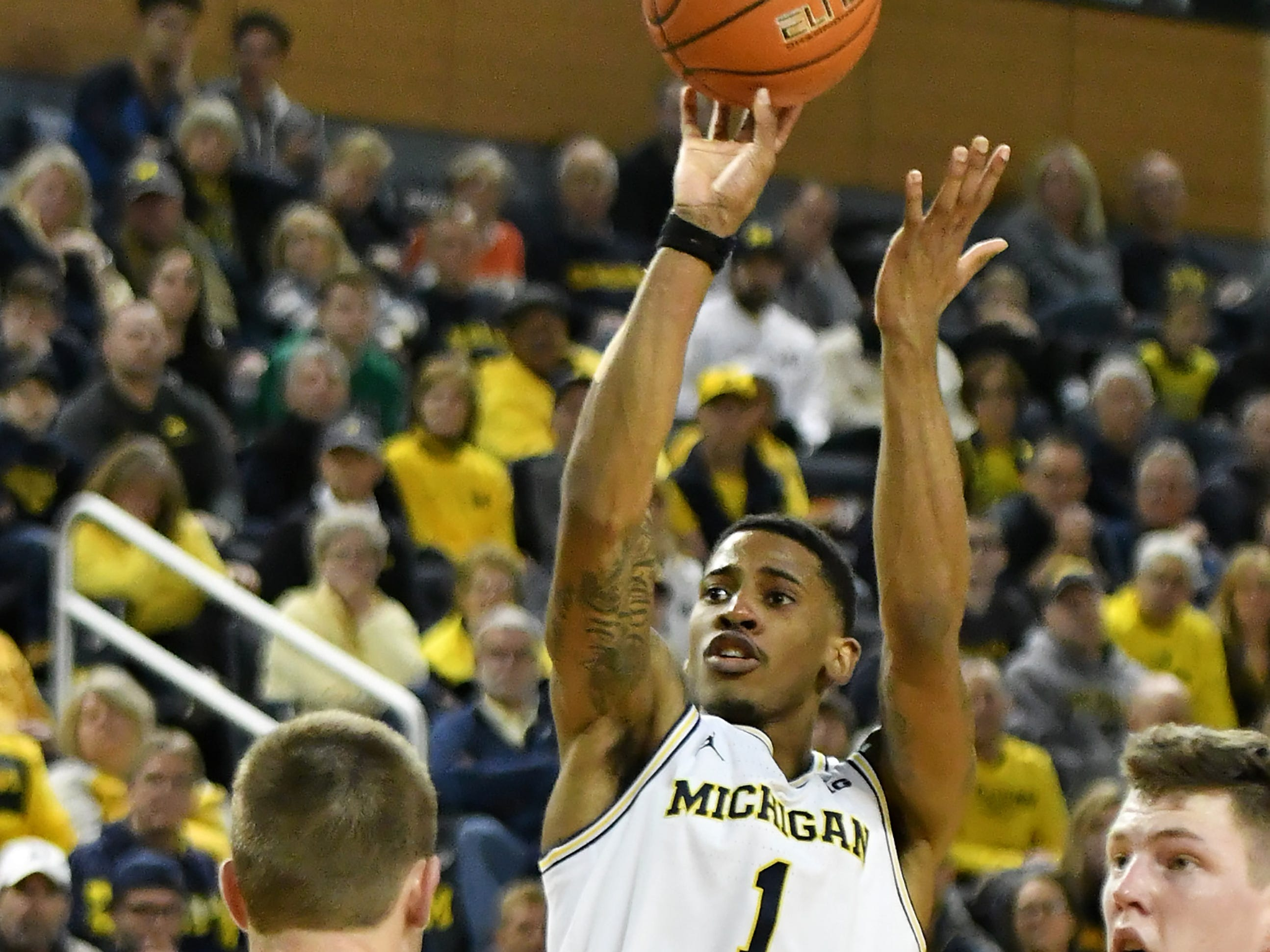 Michigan guard Charles Matthews (1) takes a shot in the second half.