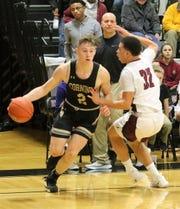 Jordan Haggard of Corning drives the baseline as Devin Dennard of Elmira defends Dec. 14, 2018 at Elmira High School.