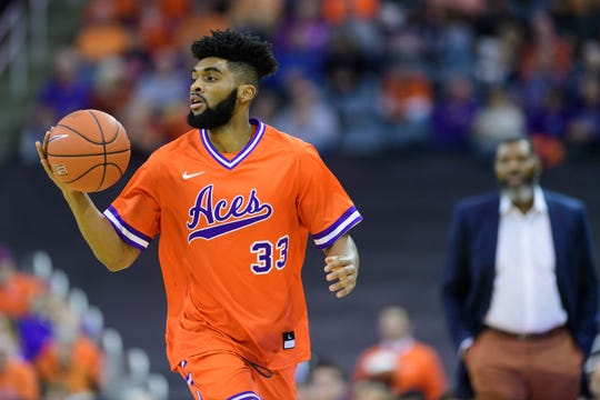 University of Evansville's K.J. Riley (33) looks to make a pass during the first half against the Jacksonville State Gamecocks at Ford Center in Evansville, Ind., Saturday, Dec. 15, 2018. The Aces fell to the Gamecocks 55-50.