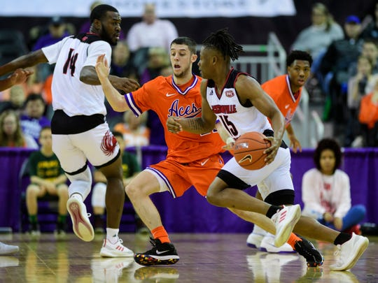 University of Evansville's Shea Feehan (21) guards Jacksonville State's Derek St. Hilaire (15) during the first half at Ford Center in Evansville, Ind., Saturday, Dec. 15, 2018. The Aces fell to the Gamecocks 55-50.