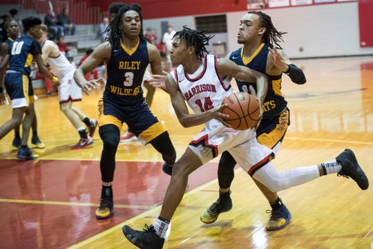 Harrison's Kel'Ondre Dixon (14) moves toward the basket during a game against South Bend Riley in the seventh annual Bosse Winter Classic Saturday, Dec. 15, 2018.