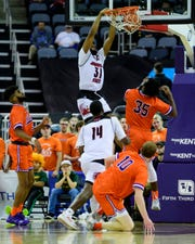 Jacksonville State's Christian Cunningham (31) dunks over University of Evansville's John Hall (35) during the second half at Ford Center in Evansville, Ind., Saturday, Dec. 15, 2018. The Aces fell to the Gamecocks 55-50.