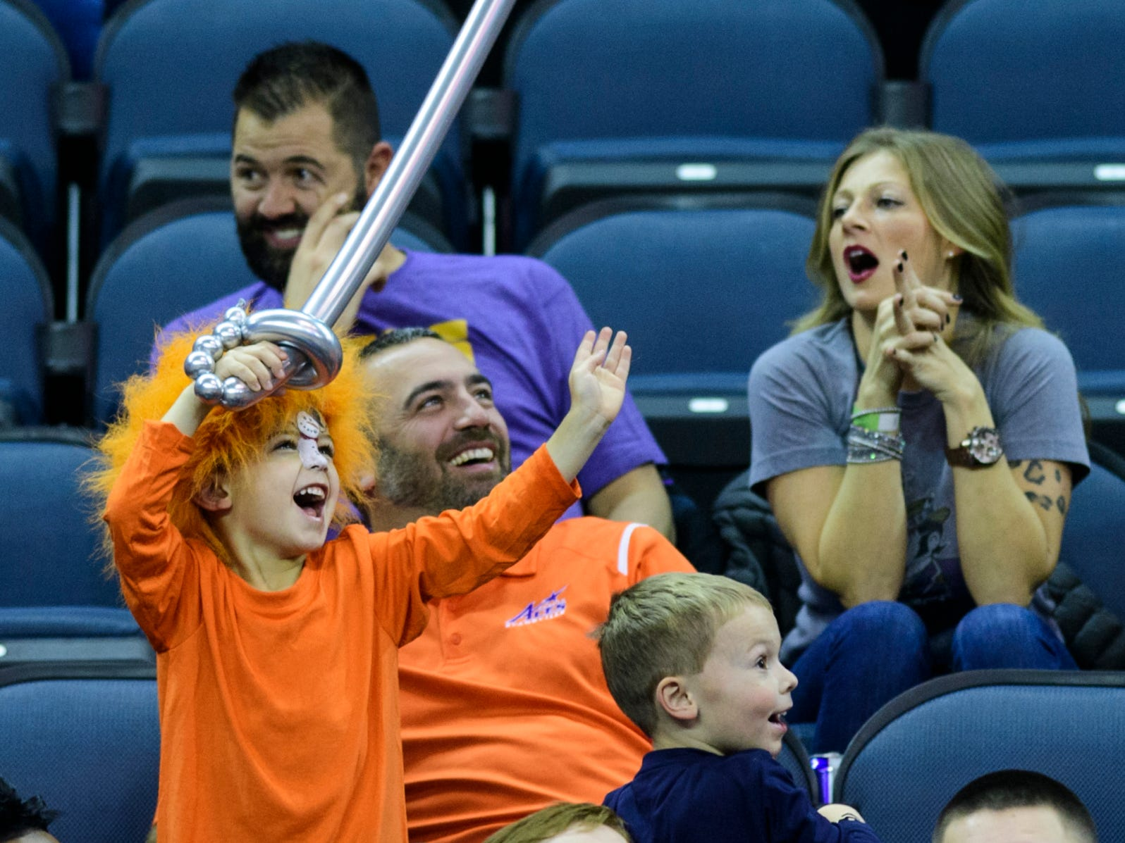Five-year-old Sammie Garau, left, makes his father Sam Garau, back, laugh while attempting to be displayed on the big screen during the Jacksonville State Gamecocks vs University of Evansville Purple Aces basketball game at Ford Center in Evansville, Ind., Saturday, Dec. 15, 2018. The Aces fell to the Gamecocks 55-50.