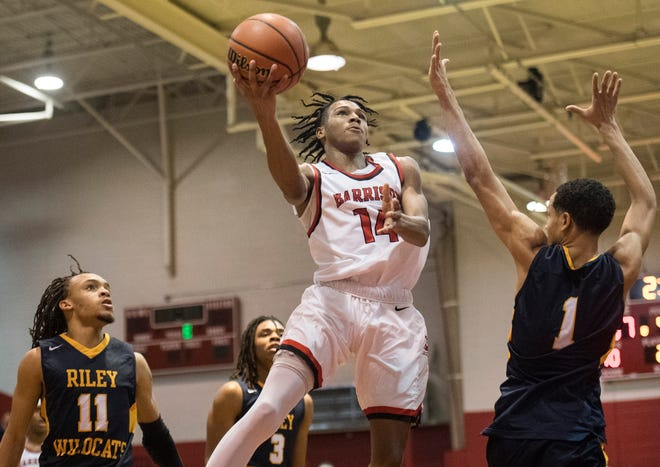 Harrison's Kel'Ondre Dixon (14) takes a shot during a game against South Bend Riley in the seventh annual Bosse Winter Classic Saturday, Dec. 15, 2018.