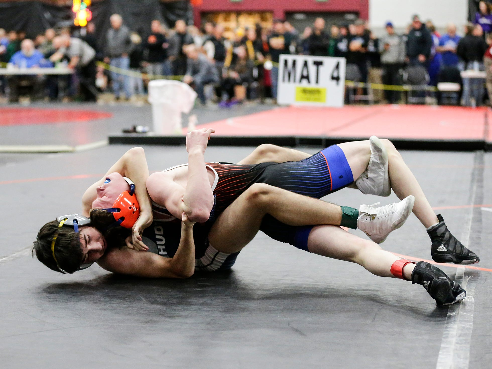 Springs/North Fond du Lac High School wrestling's Zack Williams-Romero wrestles A J Henn of Hudson High School Saturday, December 15, 2018 in the 106 pound weight class during the Fond du Lac Cardinal wrestling invitational in Fond du Lac, Wisconsin. Henn won the match 9-3. Doug Raflik/USA TODAY NETWORK-Wisconsin