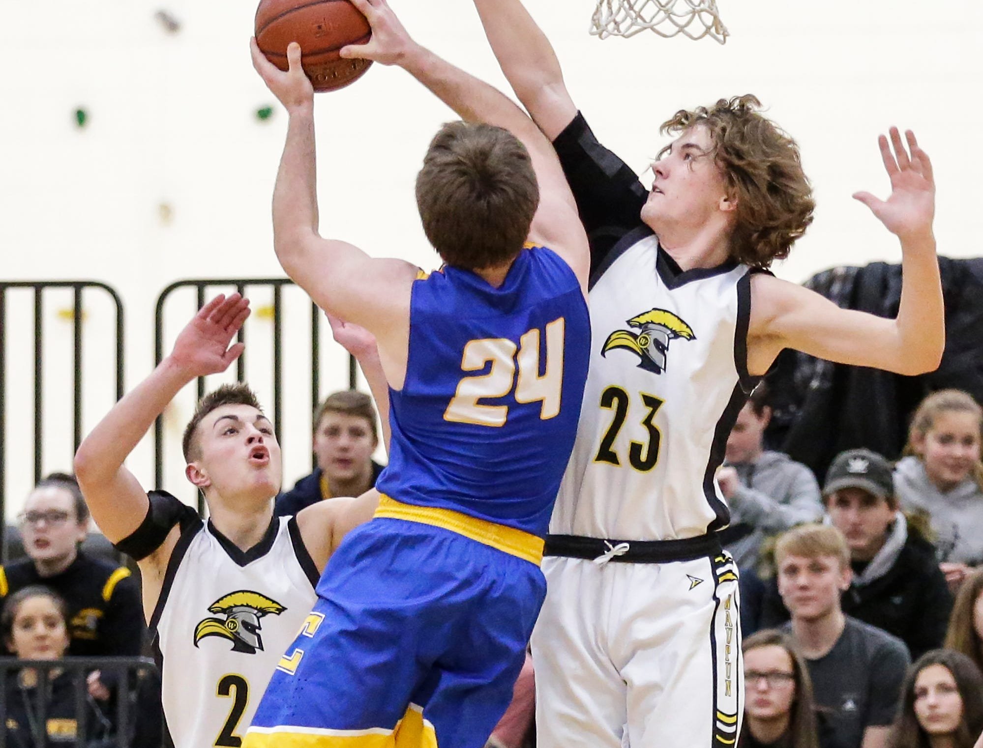Waupun High School boys basketball's Reece Homan attempts to block a shot by Campbellsport High School's Nicholas Narges during their game Friday, December 14, 2018 in Waupun. Waupun won the game 64-33. Doug Raflik/USA TODAY NETWORK-Wisconsin