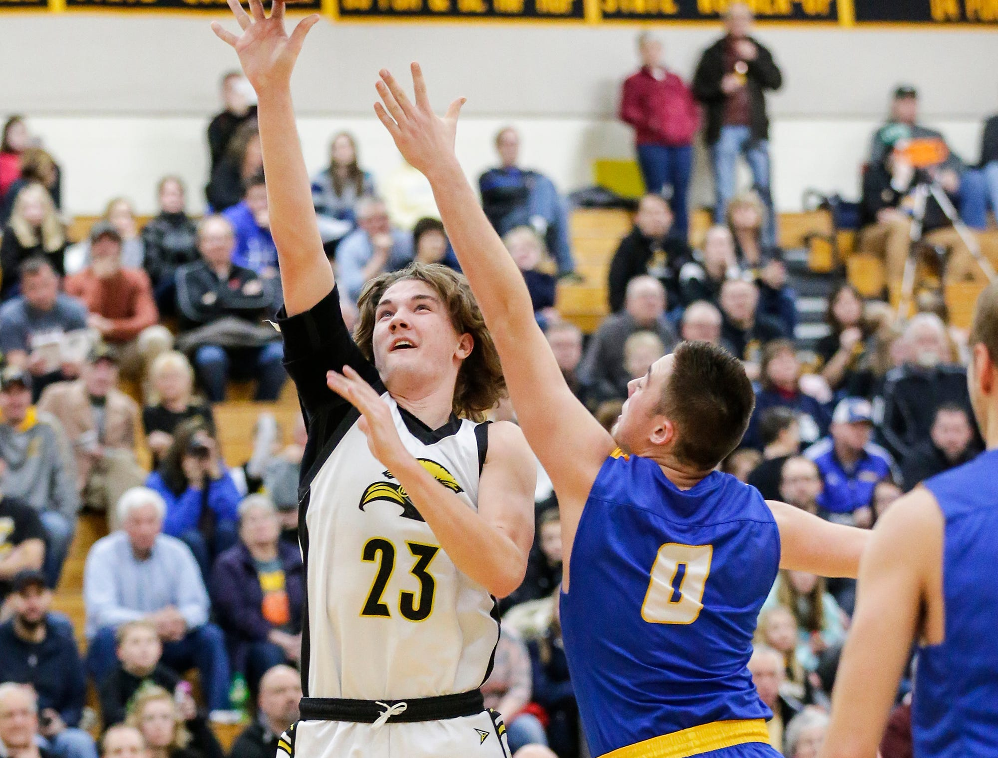 Waupun High School boys basketball's Reece Homan goes up for a basket against Campbellsport High School's Kade Walsh during their game Friday, December 14, 2018 in Waupun. Waupun won the game 64-33. Doug Raflik/USA TODAY NETWORK-Wisconsin