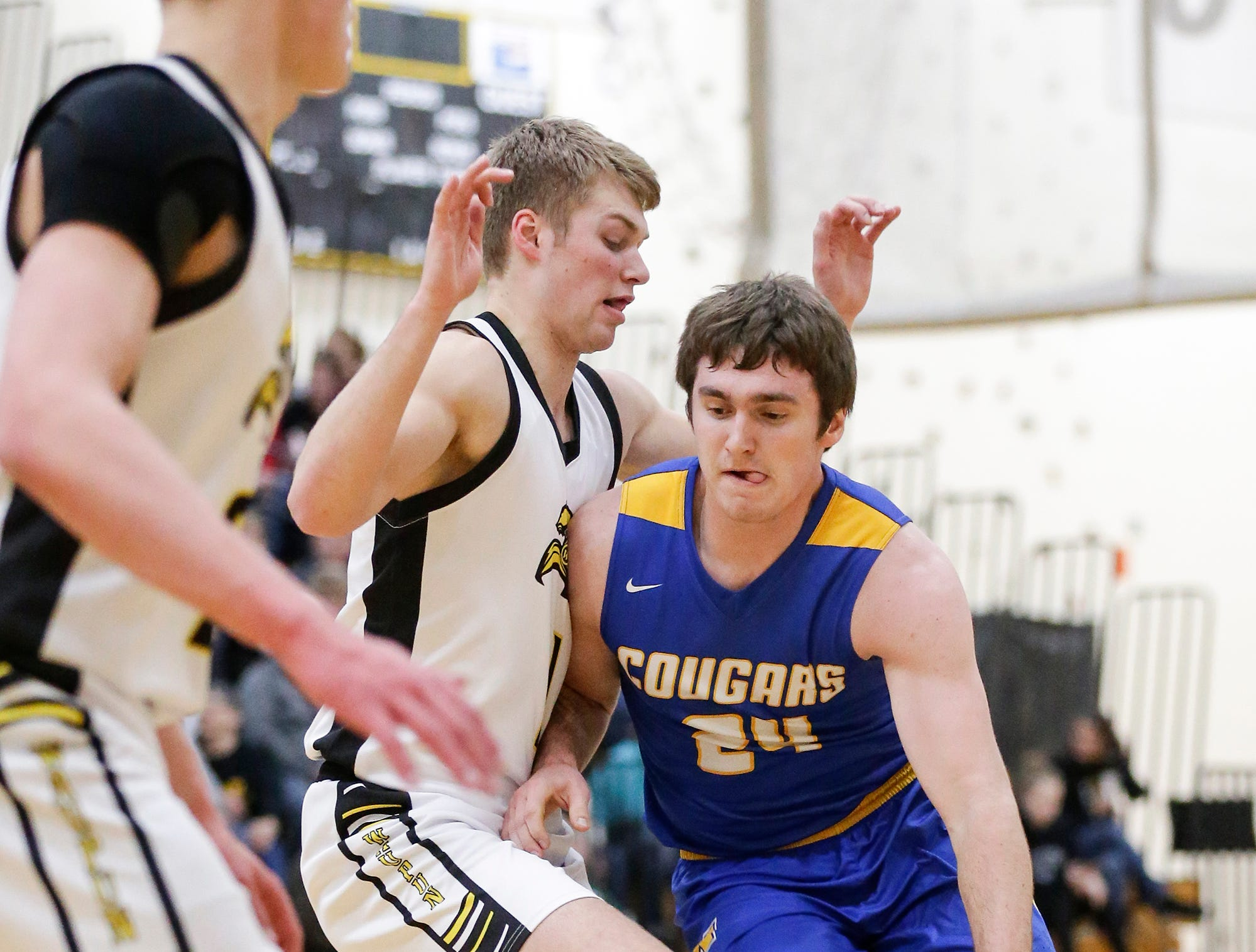 Campbellsport High School boys basketball's Nicholas Narges works his way past Waupun High School's Marcus Domask during their game Friday, December 14, 2018 in Waupun. Waupun won the game 64-33. Doug Raflik/USA TODAY NETWORK-Wisconsin