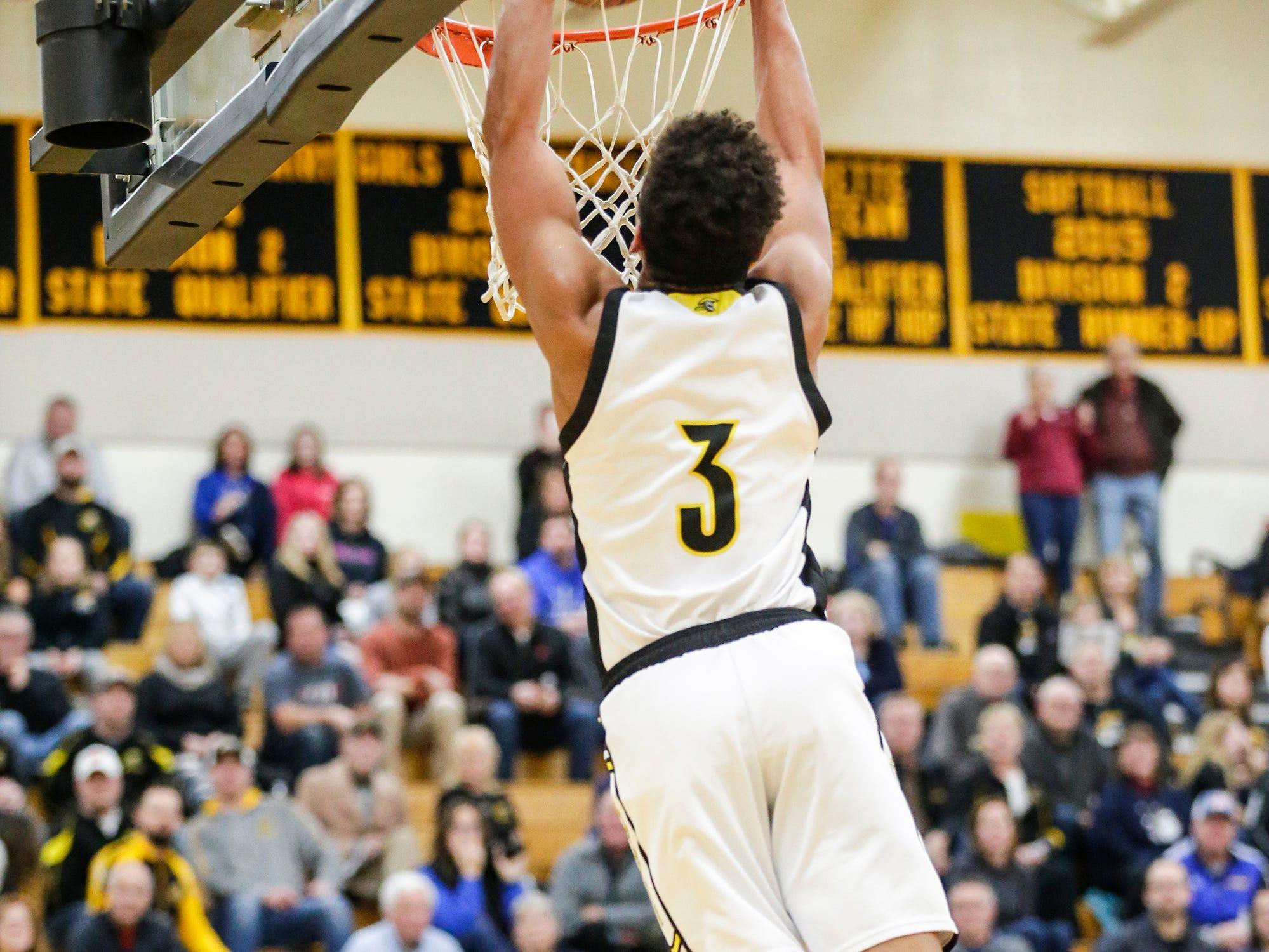 Waupun High School boys basketball's Quintin Winterfeldt dunks the ball against Campbellsport High School during their game Friday, December 14, 2018 in Waupun. Waupun won the game 64-33. Doug Raflik/USA TODAY NETWORK-Wisconsin