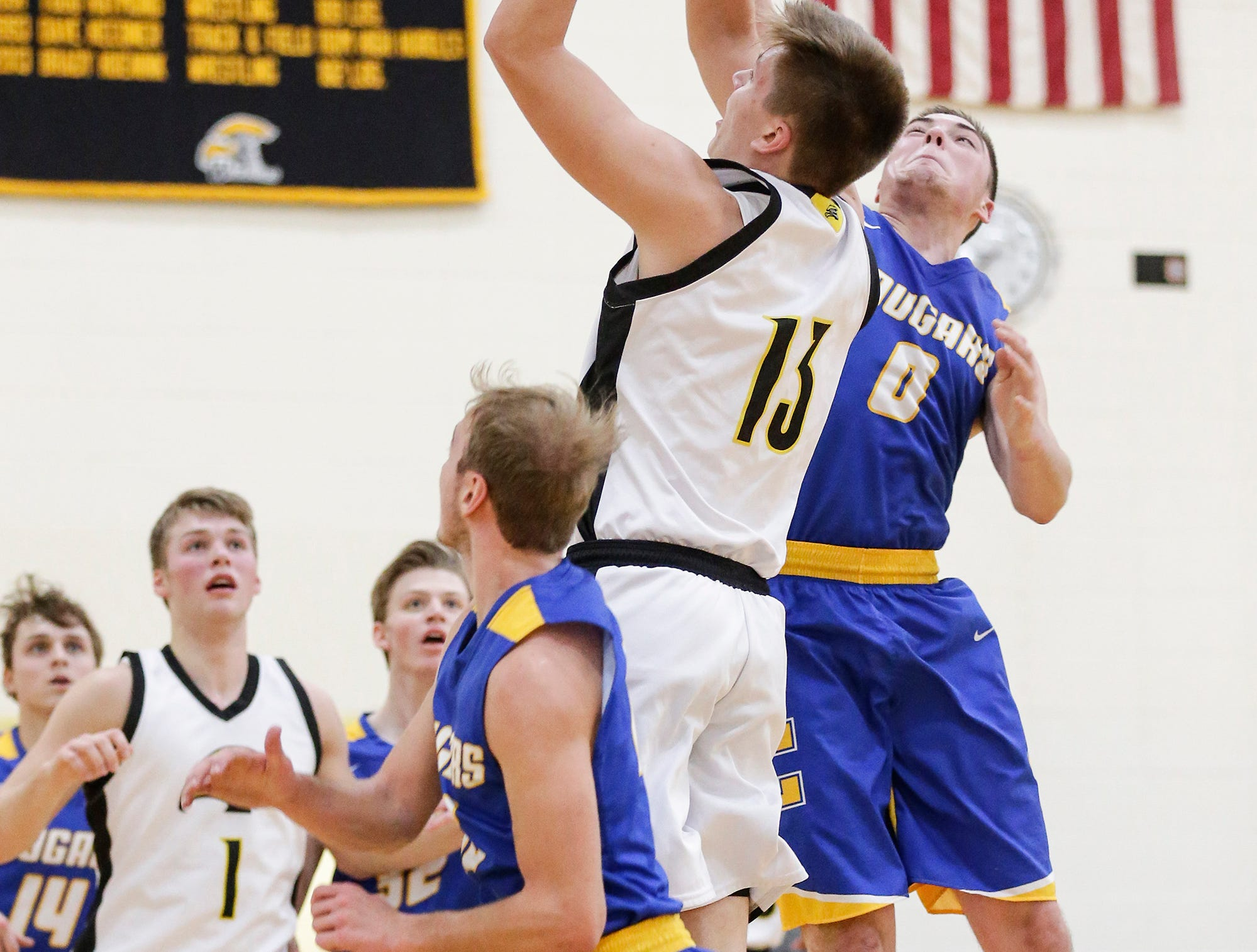 Waupun High School boys basketball's Connor Kamphuis goes up for a basket against Campbellsport High School's Kade Walsh during their game Friday, December 14, 2018 in Waupun. Waupun won the game 64-33. Doug Raflik/USA TODAY NETWORK-Wisconsin