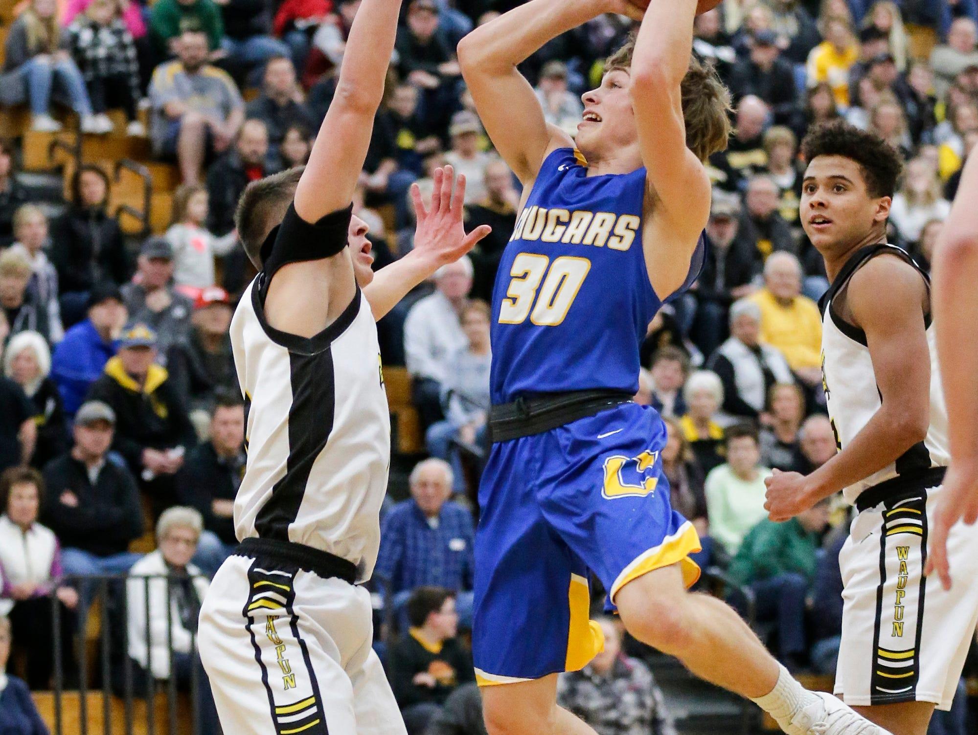 Campbellsport High School boys basketball's Jacob Johnson attempts to shoot a basket over Waupun High School's Trevor VandeZande during their game Friday, December 14, 2018 in Waupun. Waupun won the game 64-33. Doug Raflik/USA TODAY NETWORK-Wisconsin