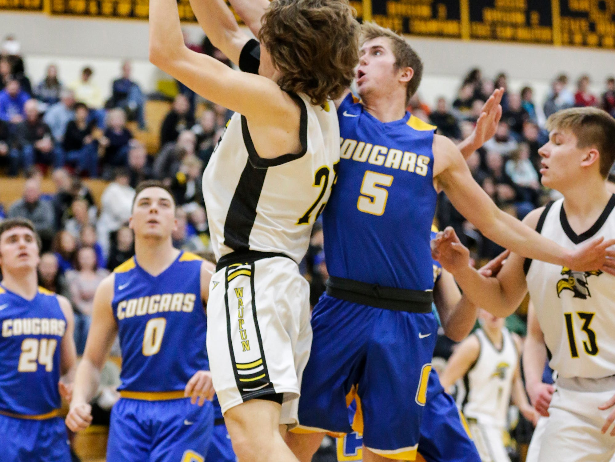 Waupun High School boys basketball's Reece Homan gets fouled by Campbellsport High School's Clay Hundertmark during their game Friday, December 14, 2018 in Waupun. Waupun won the game 64-33. Doug Raflik/USA TODAY NETWORK-Wisconsin