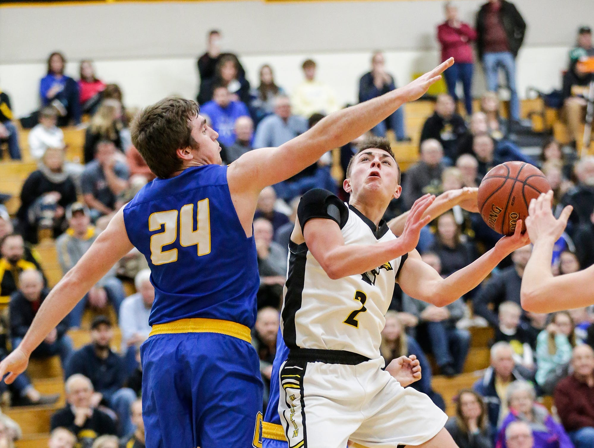Waupun High School boys basketball's Trevor VandeZande goes up for a basket against Campbellsport High School's Nicholas Narges during their game Friday, December 14, 2018 in Waupun. Waupun won the game 64-33. Doug Raflik/USA TODAY NETWORK-Wisconsin