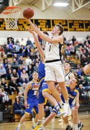Waupun senior Marcus Domask celebrated his 2,000th point of his high school career Friday in the Warriors' game against Campbellsport.