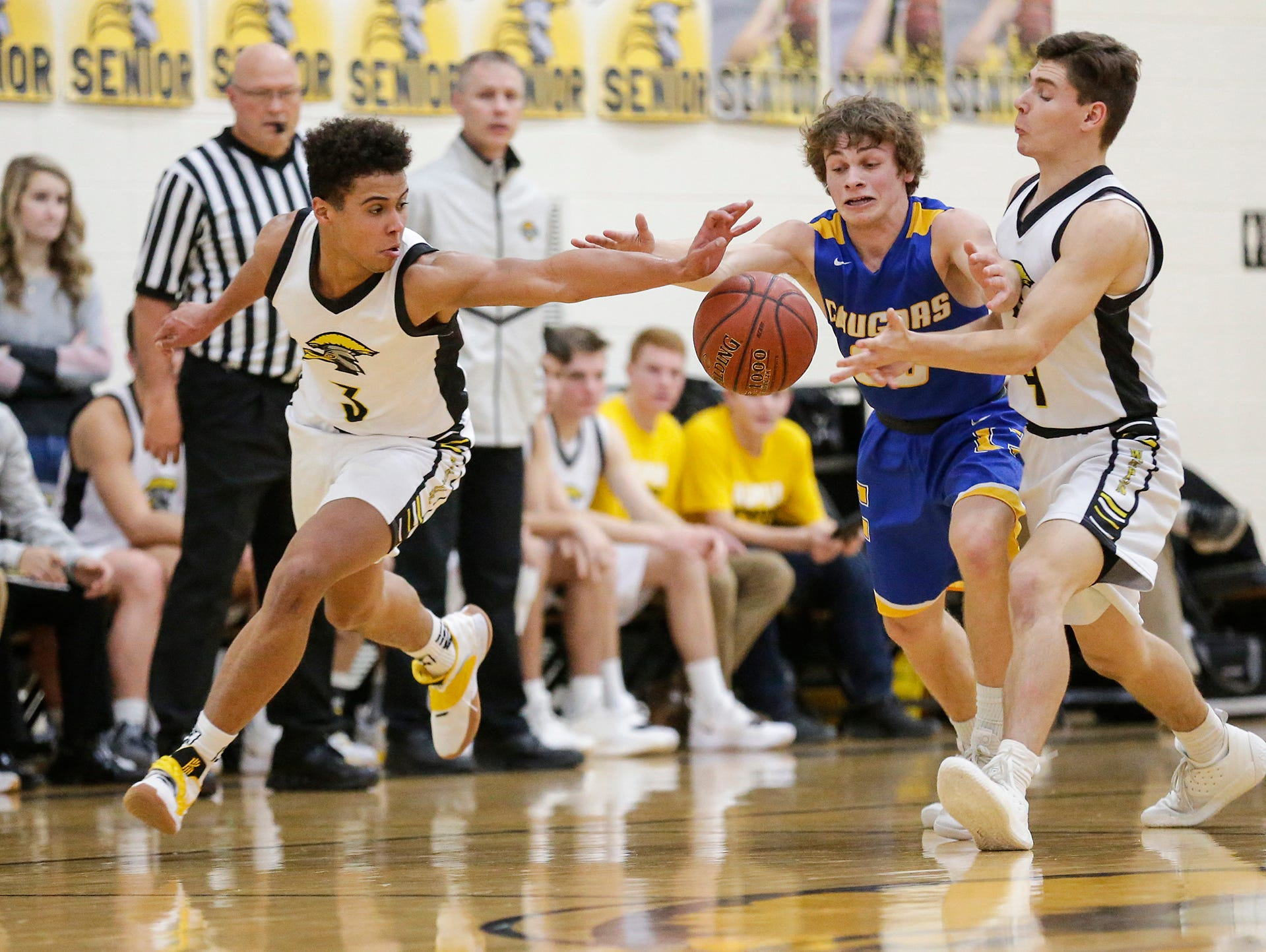 Waupun High School boys basketball's Quintin Winterfeldt (3) and Benet Veleke (4) battle for a loose ball with Campbellsport High School's Jacob Johnson during their game Friday, December 14, 2018 in Waupun. Waupun won the game 64-33. Doug Raflik/USA TODAY NETWORK-Wisconsin