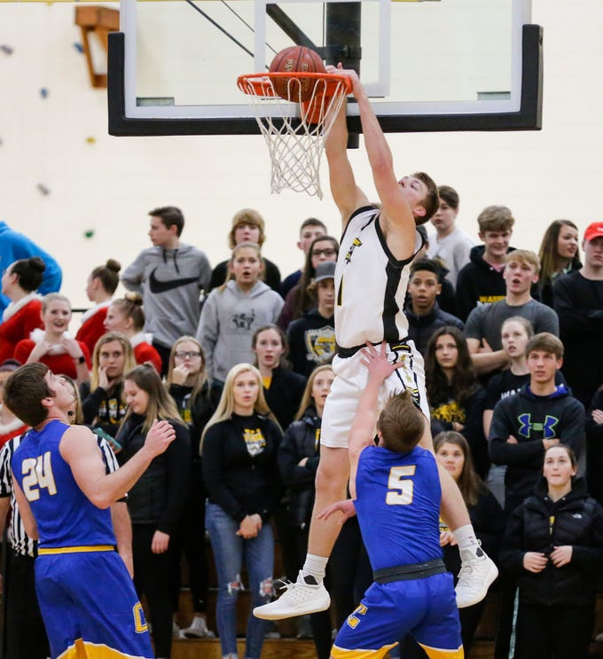 Waupun High School boys basketball's Marcus Domask dunks the ball against Campbellsport High School during their game Friday, December 14, 2018 in Waupun. Waupun won the game 64-33. Doug Raflik/USA TODAY NETWORK-Wisconsin