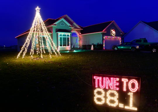 The home of Dave and Megan Riojas at 460 Burdine in Oak Harbor is decorated with an elaborate Christmas light display synchronized to music.