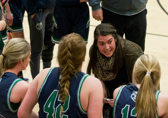 ThunderRidge Grizzlies head coach and former CSU standout basketball player Samantha Gillmore coaches her team during their game against the Lobos Friday evening Dec., 14, 2018 at Rocky Mountain High School in Fort Collins. (Michael Brian/For the Coloradoan)