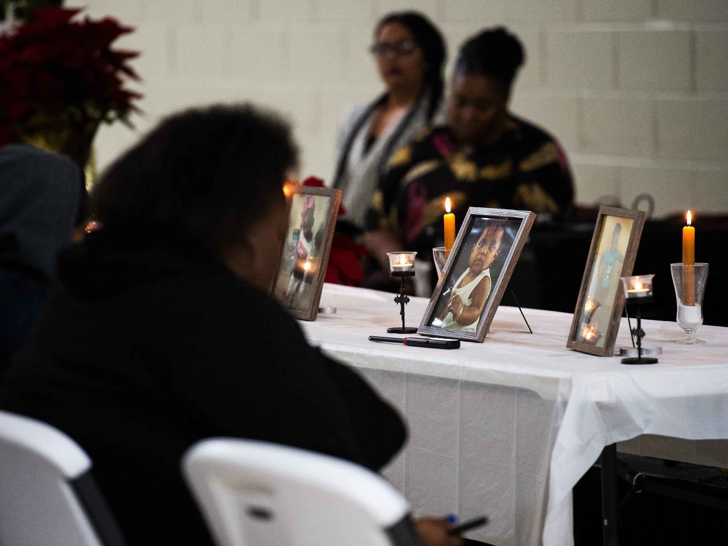 A vigil is held for siblings Arnez Yaron Jamison, Jr., 4, Robbiana Evans, 6, Jamire Halley, 8, and Ar'mani Jamison, 2, at Clearview Baptist Church on Friday, Dec. 14, 2018.