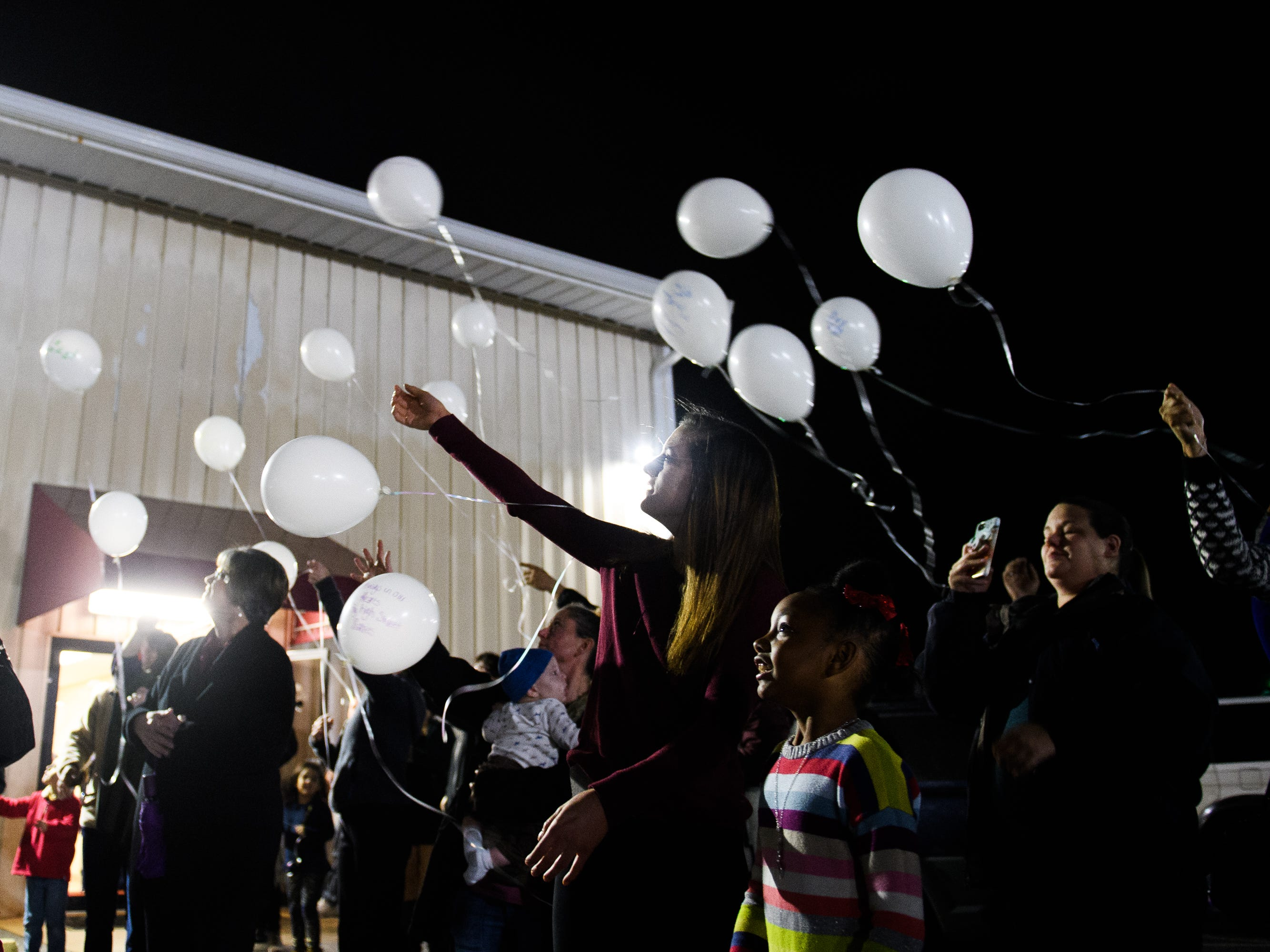 Loved ones of siblings Arnez Yaron Jamison, Jr., 4, Robbiana Evans, 6, Jamire Halley, 8, and Ar'mani Jamison, 2, release balloons to honor their life during a vigil at Clearview Baptist Church on Friday, Dec. 14, 2018.