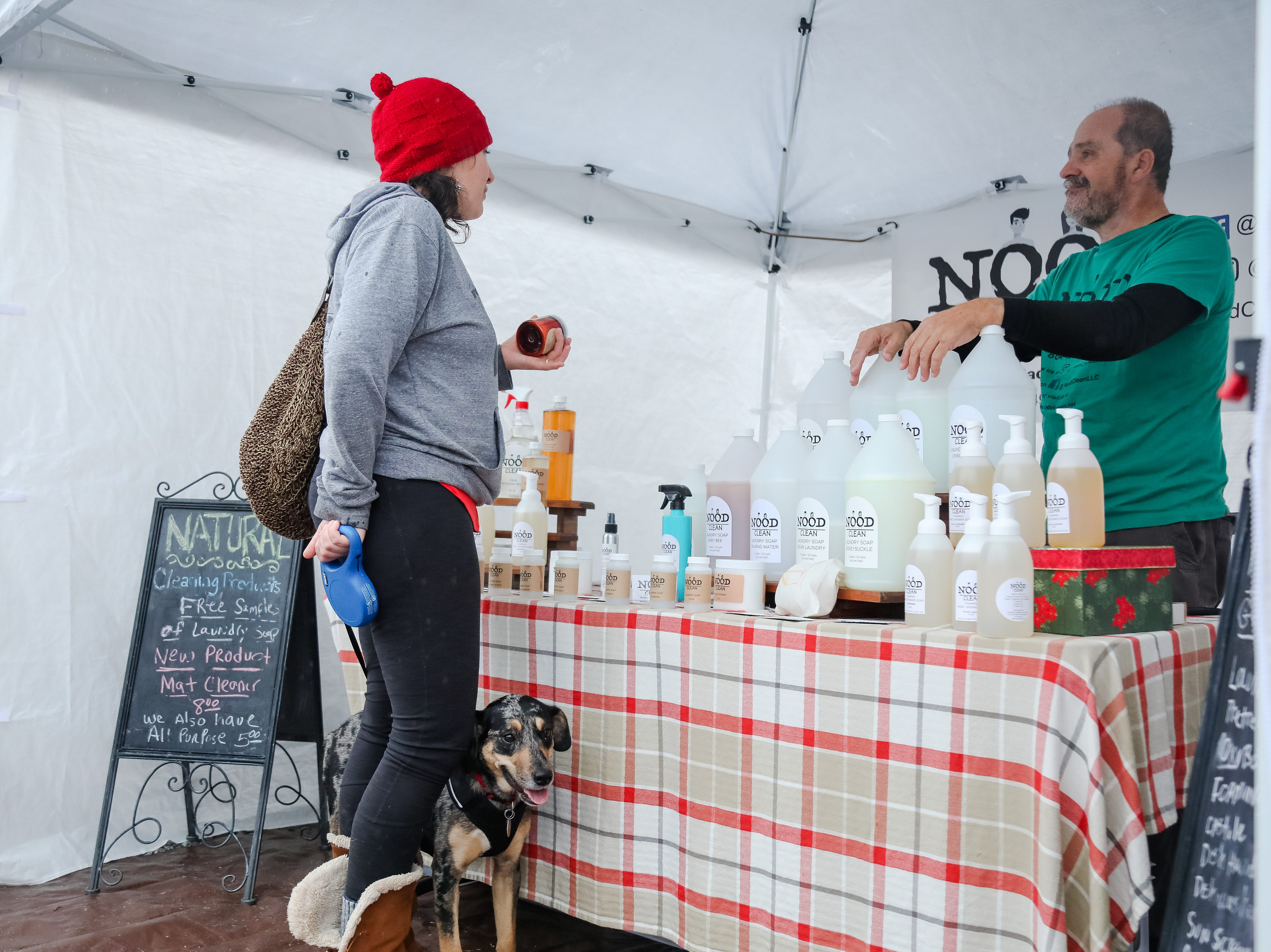 Rebekah Synder and her dog Pepper buy some laundry soap from  Jim at the Nood Clean.  The Swamp Holiday Flea at the Swamp Rabbit Cafe & Grocery featuring local artists, woodworkers, candle makers, potters, and dog-treat bakers.  In addition to 40+ vendors, and  music from a local acoustic band. Saturday December 15,2018