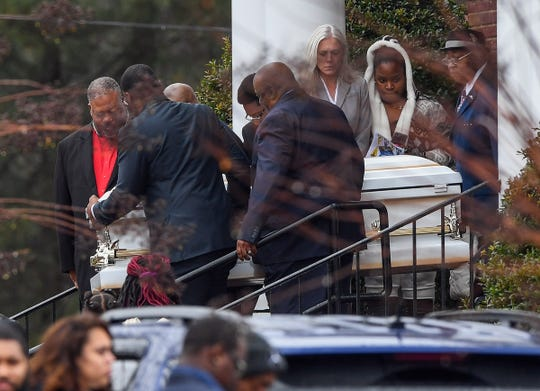 One of four caskets of the four children of Jacqueline Brown is taken from Mountain Creek Baptist Church in Greenville after their funeral Saturday, December 15, 2018.