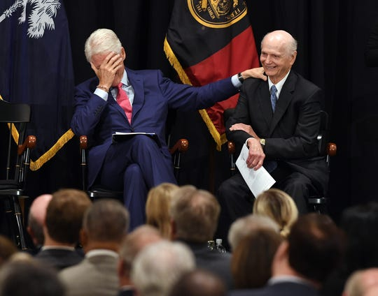 Former President of the United States Bill Clinton laughs with Sec. Richard W. Riley during a program in Columbia on Monday, August 6, 2018 to introduce the Richard W. Riley Collection on display in the Ernest F. Hollings Special Collections Library of the Thomas Cooper Library located on the campus of the University of South Carolina.