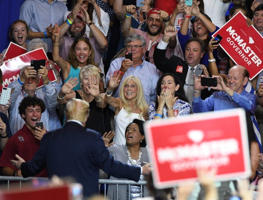 President Donald Trump supporters cheer as the president arrives at the McMaster-Trump Rally in West Columbia Monday, June 25, 2018. 