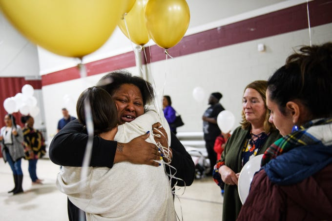 Jacqueline Brown is embraced by Angela Stone at Clearview Baptist Church during a vigil held in honor of Brown's four children who died due to a DUI wreck on Friday, Dec. 14, 2018.