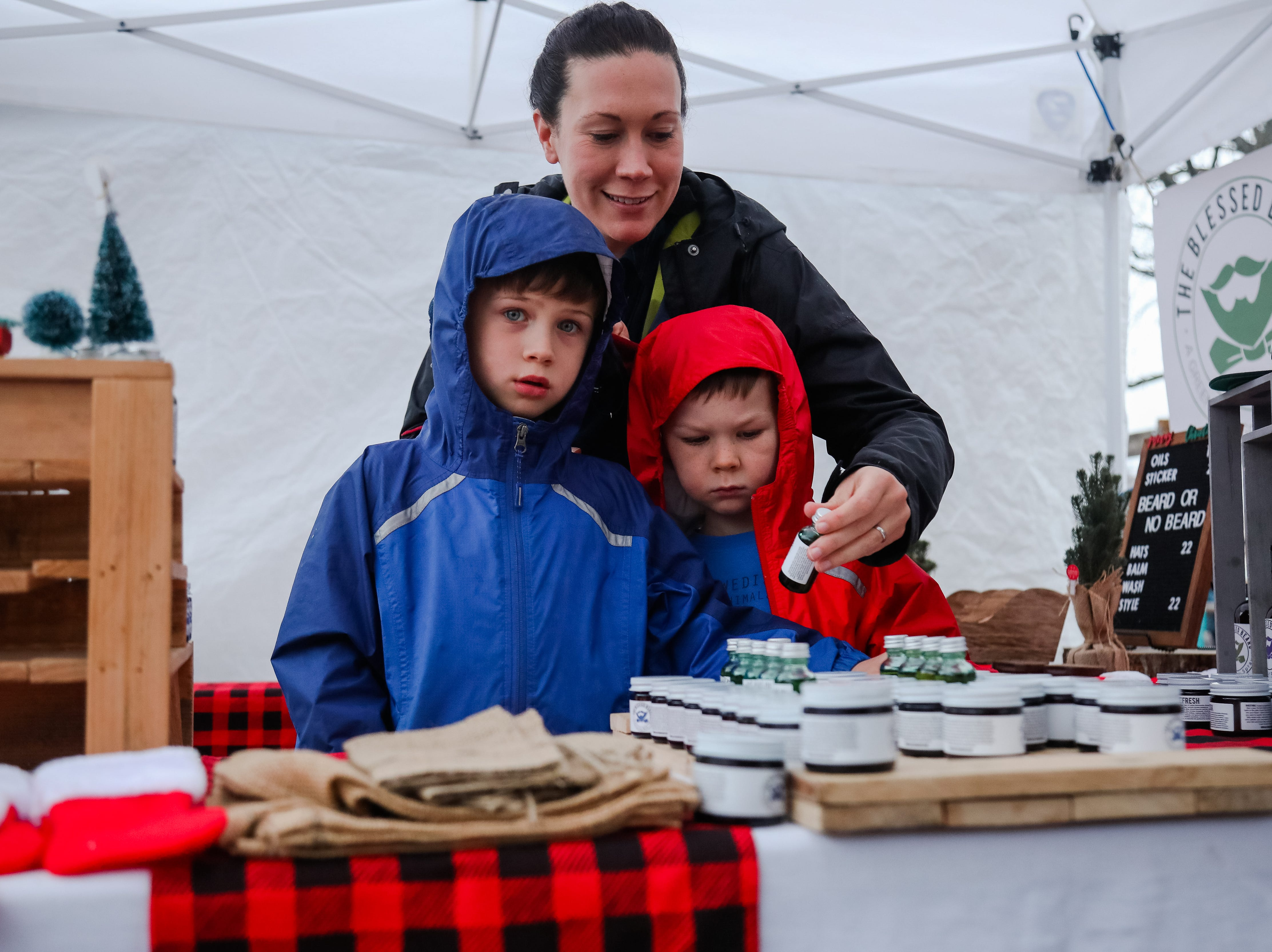 Cade and Ezra Samples shop with their mom Melanie. The Swamp Holiday Flea at the Swamp Rabbit Cafe & Grocery featuring local artists, woodworkers, candle makers, potters, and dog-treat bakers.  In addition to 40+ vendors, and  music from a local acoustic band. Saturday December 15,2018