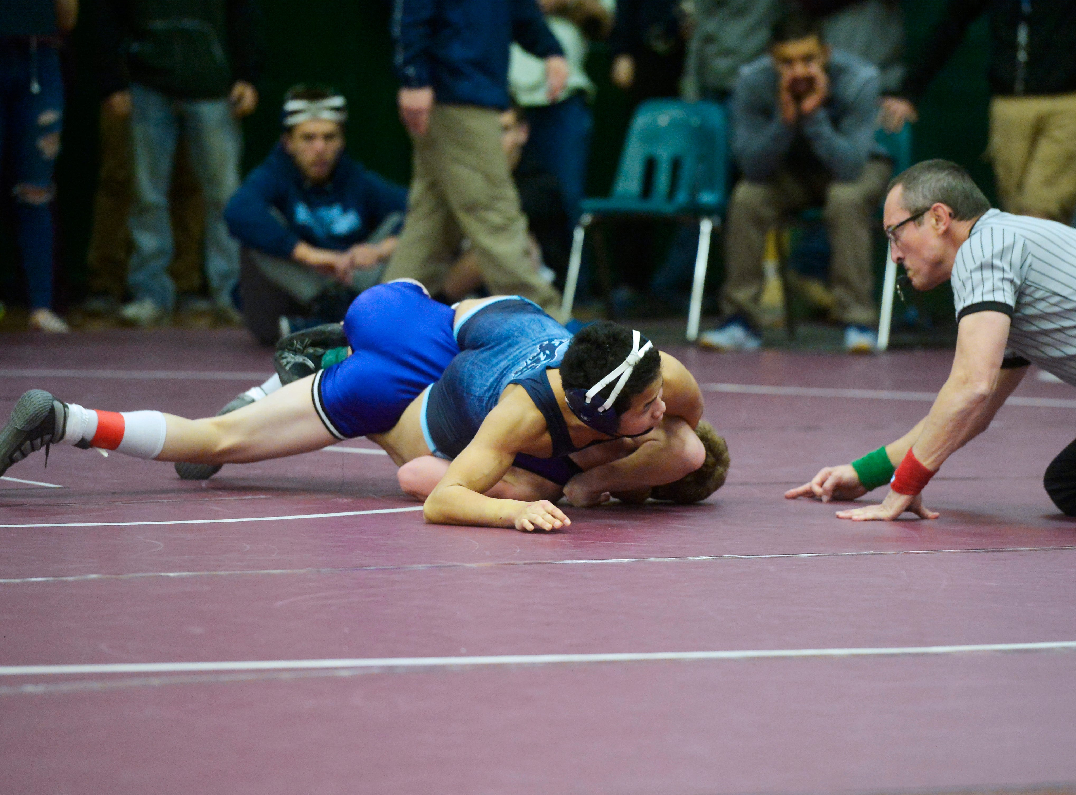 Great Falls High's Austin Phattavong attempts to pin Forsyth's Camron Reilly during the CMR Holiday Classic Wrestling Tournament in the CMR Fieldhouse on Friday.