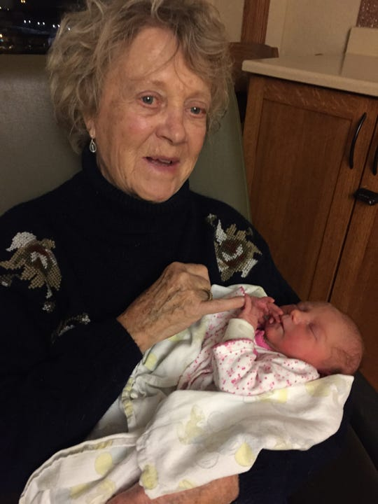 Patsy (Eckley) Hall and one of her great-children.