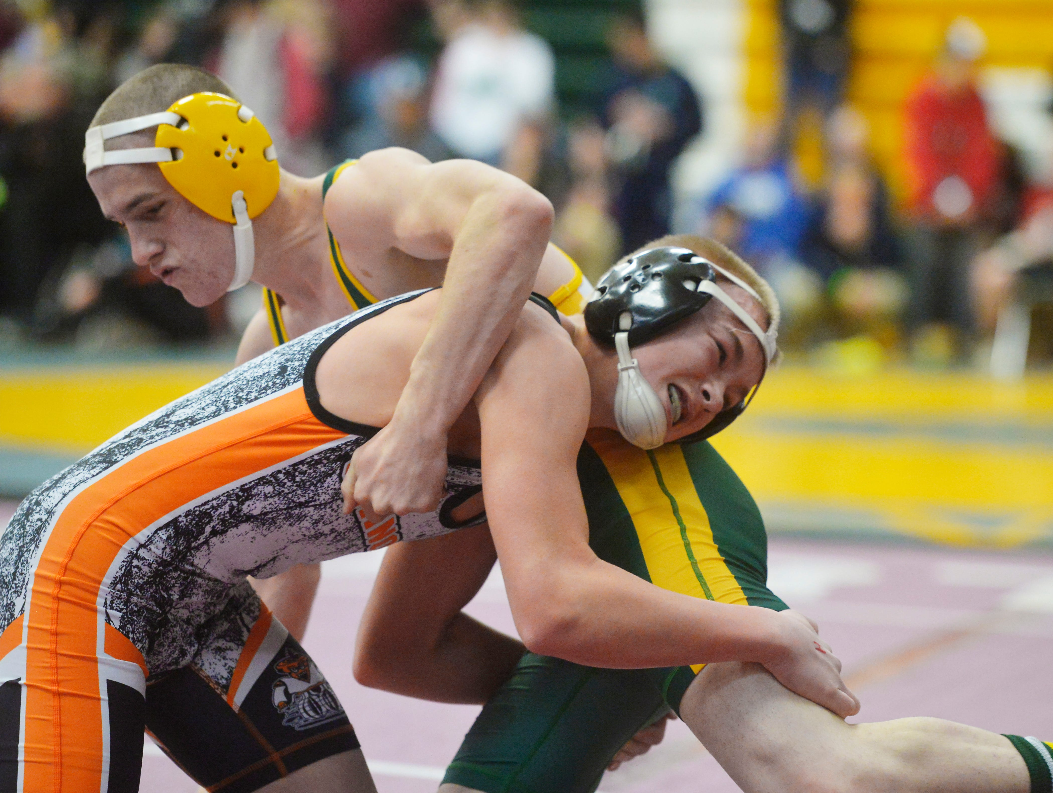 CMR's Logan Sherwood and Chinooks Ethan Liddle battle for position on the mat during the CMR Holiday Classic Wrestling Tournament in the CMR Fieldhouse on Friday.