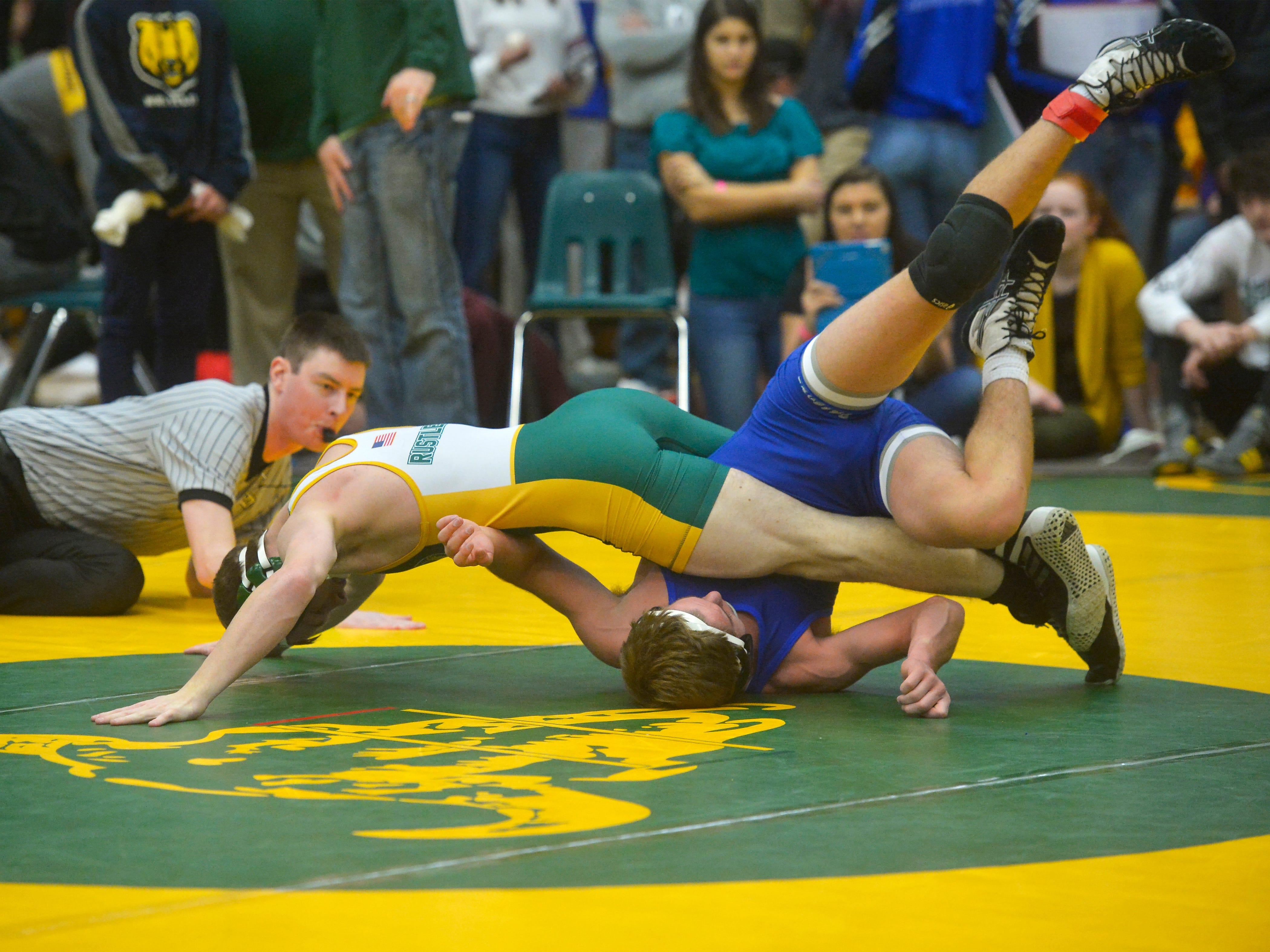 CMR's Andrew Paradise records a pin on SKyview's Dylan Emborg during the CMR Holiday Classic Wrestling Tournament in the CMR Fieldhouse on Friday.
