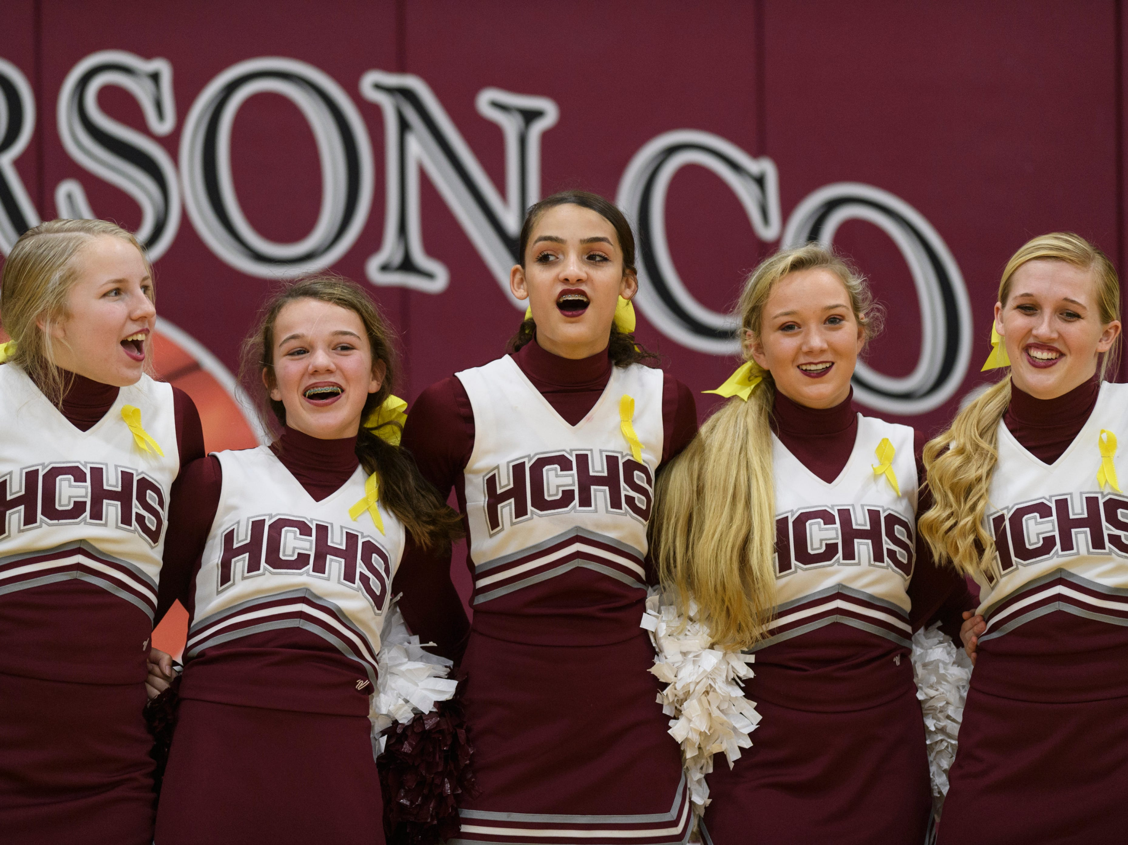 "Members of the Henderson County Cheerleading team sing  along to the song ""My Old Kentucky Home"" as it plays at the end of the Christian County Colonels vs Henderson County basketball game at Henderson County High School in Henderson, Ky., Friday, Dec. 14, 2018. Christian County defeated Henderson County 79-71."