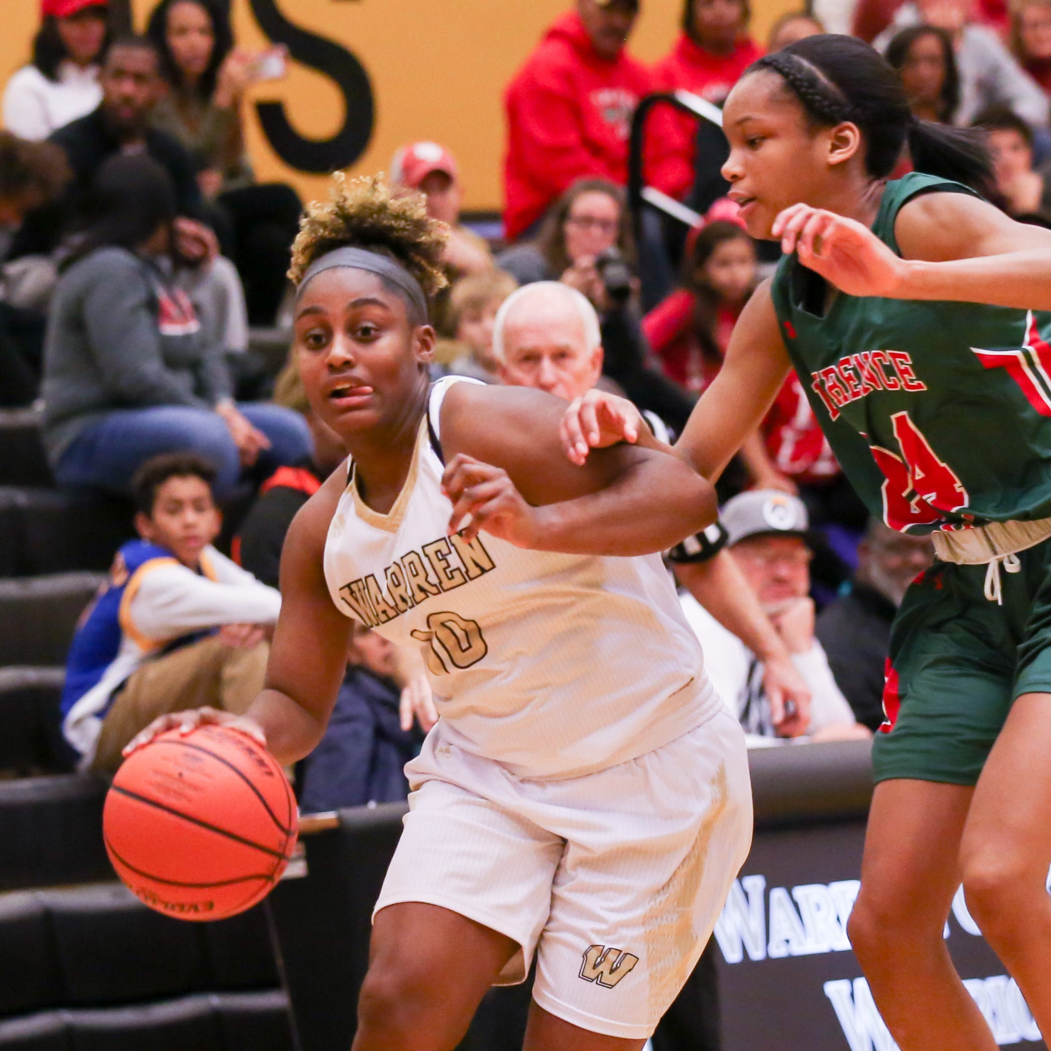 Warren Central's Shaila Beeler (10) drives around Lawrence North's Jayla Smith (24) during the second half of Lawrence North vs. Warren Central High School varsity girls basketball held at Warren Central High School, December 14, 2018.