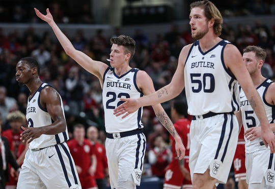 The Butler Bulldogs invite fans to celebrate their lead in the first half of the Crossroads Classic game between Butler and IU at Banker's Life Fieldhouse in Indianapolis, Saturday, Dec. 15, 2018.