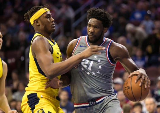 Dec 14, 2018; Philadelphia, PA, USA; Philadelphia 76ers center Joel Embiid (21) drives against Indiana Pacers center Myles Turner (33) during the third quarter at Wells Fargo Center. Mandatory Credit: Bill Streicher-USA TODAY Sports