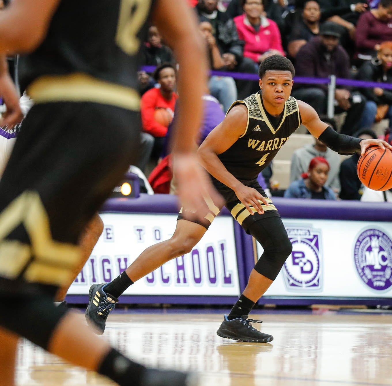 Warren Central High School's Manuel Brown Jr. (4) looks to run a  play during a game between Ben Davis High School and Warren Central High School at Ben Davis on Friday, Dec. 14, 2018.