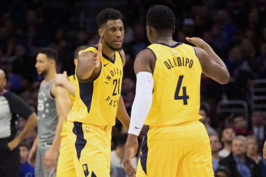 Dec 14, 2018; Philadelphia, PA, USA; Indiana Pacers forward Thaddeus Young (21) reacts with guard Victor Oladipo (4) after scoring against the Philadelphia 76ers during the fourth quarter at Wells Fargo Center. Mandatory Credit: Bill Streicher-USA TODAY Sports